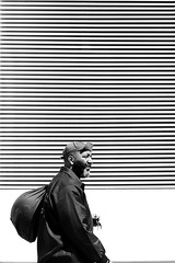 In front of the lined wall (pascalcolin1) Tags: paris13 homme man sac bag mur wall lined rayé photoderue streetview urbanarte noiretblanc blackandwhite photopascalcolin 50mm canon50mm canon