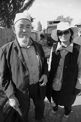 Karakol Couple (peterkelly) Tags: bw digital canon 6d kyrgyzstan karakol livestockauction vendor merchant wife hat couple husband beard sunglasses gadventures centralasiaadventurealmatytotashkent market bazaar