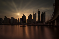 Desert Sunset - Well it used to be one! (Aleem Yousaf) Tags: dubai united arab emirates uae brown golden hour sunset sunrays water long exposure business bay alabraj street canal reflections skyline clouds sky style processing outside day nikkor sunshine low key silhouette design architecture steel metal middle east walking view happy outdoor dxb lee little stopper nikon d810 flickr burj khalifa damac properties wide angle desert