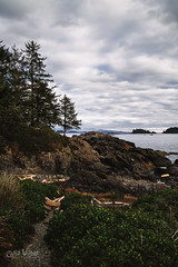 The Wild Pacific (wilbias) Tags: amphitrite point lighthouse wild pacific trail hiking rocks rocky west coast vancouver island ucluelet bc british columbia canada vertical sunset cloudy