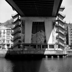That's a tall bridge (Gabo Barreto) Tags: bilbao paisvasco basquecountry bridge lasalve river under stairs water film 120 6x6 mediumformat analoguephotography filmcamera tlr twinlensreflex yashicamat kodak trix selfdeveloped scannedfromfilm blackandwhite monochrome filmisnotdead squareformat