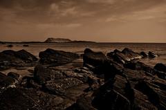 Tramonti (Claudio Taras) Tags: contrasto controluce shadow sardegna sepia santeodoro bw bokeh sabbia monochrom mare spiaggia onde claudio taras nikon natura cielo oceano roccia acqua tramonto paesaggio autofocus