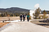 Group of cyclists at Old Faithful (YellowstoneNPS) Tags: oldfaithful uppergeyserbasin ynp yellowstone yellowstonenationalpark biking construction people recreation spring