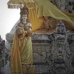 Balinese Hindu Temple Complex, Menjangan Island, Bali (scinta1) Tags: bali menjangan island temple pura shrine goddess hindu stonestatue stonework yellow woman tedung
