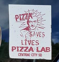 Pizza Saves Lives (rabidscottsman) Tags: scotthendersonphotography sticker sd southdakota deadwoodsouthdakota pizza food wednesday cellphonephotography advertising centralcitysouthdakota pizzalab usa unitedstatesofamerica socialmedia