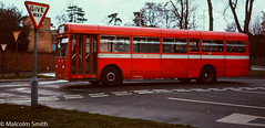 The Merlin - Summer 1971 (M C Smith) Tags: aec merlin red mb road roads signs letters buildings verge grass green cone wall trees branches sky blue lamps lines white