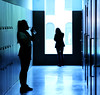 Friends no more (Wilamoyo) Tags: girls friends silhouette blue lockers school kids drinking two figures light corridor