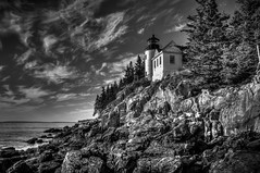 Bass Harbor in Black & White (donnieking1811) Tags: maine bassharbor tremont bassharborheadlighthouse outdoors cliffs trees sky clouds landscape acadianationalpark acadia lighthouses hdr canon 60d lightroom photomatixpro blackandwhite bw crag water