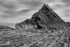 Natural Sculpture (evans.photo) Tags: coastalpath rocks blackandwhite erosion ceredigion geology aberystwyth coast wales