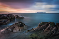 Seaside Sunset (Minibert93) Tags: seascape sunset clouds colour eastcoast dublin ireland longexposure bigstopper canon nisi rocks reflections 40ft railing