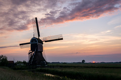 A gorgeous sunset (Rob Schop) Tags: spring grootammers zonsondergang sunset sonya6000 molens nederland outdoor clouds skyscape sigma30mm14 red lente windmill a6000 landscape wolken colour