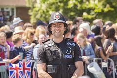 Happy policeman (Steve M Photography) Tags: windsor windsorcastle royalwedding royalfamily princeharry policeman crowds celebration spectators law policeofficer funny laughing enjoyment