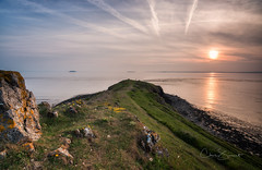 The Figure at the Point (Chris Sweet Photography) Tags: seascape landscape goldenhour sunset nisi nikon sandpoint sandbay coast coastal ocean sea rocks peninsula