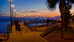 Waterfront Sunset - Limassol, Cyprus (Andreas Komodromos) Tags: clouds cyprus europe lights limassol mediterranean people pier sea seafront shadow sky sunset water waterfront landscape seascape night nightshot photography travel vacation winter sunlight sony a6000 alpha light dusk evening flickrtravelaward nyandreas nightphotography world trekker worldtrekker destination colorful colour color shadows