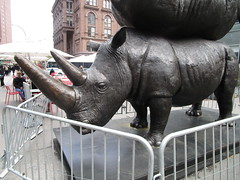 The Last Three - Rhino Stacking Sculpture - Astor Place NYC 0739 (Brechtbug) Tags: the last three rhino sculpture by gillie marc astor place nyc 2018 new york city sign 17 foot high raising critical awareness over conservation northern white art statue animal animals standing each other stacked stacking bronze horn horns fresh air creatures almost extinct not zoo sidewalk street streets downtown scene east village cooper union