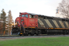 Squandered (view2share) Tags: cn2407 c408m ge generalelectric may22018 may2018 may 2018 516 l516 cn516 cnl516 cowl newrichmond wisconsin wi eastbound engine evening minneapolissub rr railway railroading railroads railroad rail rails railroaders rring track transportation trains tracks transport trackage train trees freight freighttrain freightcar freightcars stcroixcounty grass zebra cn canadiannational warm spring springtime dusk twighlight westernwisconsin