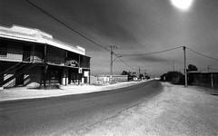 1299 (The Dent.) Tags: kodakhawkeyesurveillancefilm south australia coober pedy tmx dev 19 10 mins 2485 analogphotography nikon f100 24mm red filter desert outback wreckage