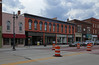 Building — Albion, Michigan (Pythaglio) Tags: calhouncounty michigan historic building structure commercial albion twostory brick storefronts street barrels construction 11windows roundarched windows hoodmolds tile cornice sidewalk cars automobiles 1878