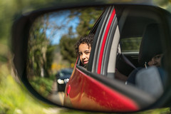 The longer we keep looking back in the rearview mirror, it takes away from everything that's moving forward. Dan Quinn (Lorrainemorris) Tags: kidsplaying sony7rm2 sony batis zeiss ireland rearviewmirror kids candid colours bokeh redcar mirror roadtrip car tree road