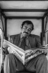 A candid street portrait (Frederik Trovatten) Tags: portrait streetphotography streetphoto blackandwhite blackandwhitephotography black white man sitting reading newspaper mexico mexican hombre fuji fujifilm streets streetportrait portraits streetphotographer