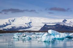 Early morning at the lagoon (Oleg S .) Tags: iceland jokulsarlon nature water mountains reflection lake glacier iceberg ice