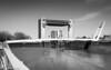Kingston upon Hull -27.jpg (Colin Dorey) Tags: hull kingstonuponhull riverhull humber water river bridge yorkshire may 2018 bw monochrome blackandwhite blackwhite sky landscape architecture structure building tidalsurgebarrier tidalbarrier footbridge premierinn