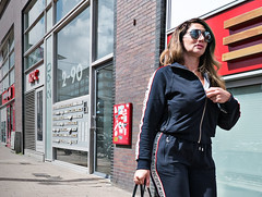 she's leaving (digitri aka paz) Tags: streetphotography candid street polychrome color city people woman sport gym digitris digitri givenchy paz