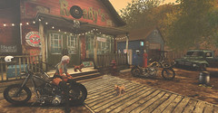 Small town vibe... (kellytopaz) Tags: small town second life motorcycle bar garage rustic dog pick up