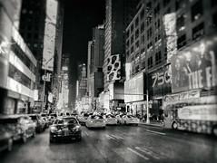 New York City in B&W (` Toshio ') Tags: toshio nyc newyorkcity manhattan taxi cab car street city timessquare midtown road bw blackandwhite iphone neon night traffic