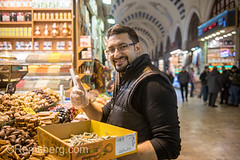Adult male gives a thumbs up as he restocks bins in front of spice shop at Istanbul Spice bazaar in Turkey (Remsberg Photos) Tags: bazaar market souk spice istanbul turkey egyptianbazaar commerce business retail shopping exchange commodities vendor portrait adult male merchant forsale smiling happiness joy marketplace indoor products eminonuquarter fatihdistrict middleeast famousplace traveldestination consumerism happy thumbsup economy
