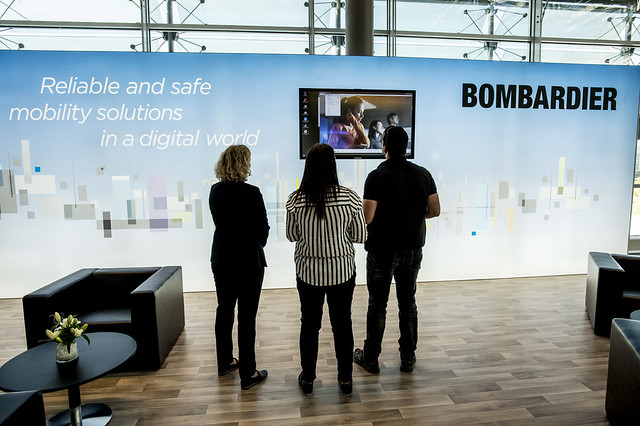 Attendees looking at the display at Bombardier's stand