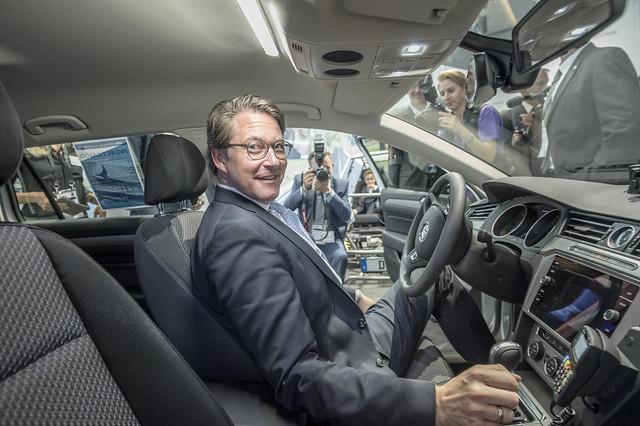 Andreas Scheuer testing a car