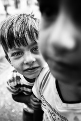 Still happy after the war (Giulio Magnifico) Tags: curiosity leicaq civilwar friends iraq leica kurdistan blackandwhite refugeescamp muslim camp desert kurdish deepsoul boy iraqi iraqturchia children middleeast future refugees portrait italy happy bw happiness 28mm isis yazidi catholic nikon