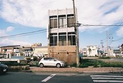 Standing alone (cactus_chef) Tags: japan 2016 olympus om1 fujifilm fuji film iso200 iso 200 iso400 olympusom1 travel 28mm 50mm 18 f18 f28 om bellhowell 50mmf18 28mmf28 backpacking ishinomaki miyagi miyagiprefecture tsunami building survivor street xperia ruins desolate