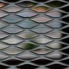 Vista parcellizzata. Partitioned view (grids) (sandroraffini) Tags: grid griglia forma onda wave shaped blurred vision sfocata vista pattern metallo metal light tiles piastrelle luve urban detail fragment dettaglio exploration abstract reality canon eos80d 70200 sabdroraffini bologna lines curves linee curve via massarenti optical