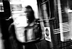 Immigration (draketoulouse) Tags: chicago loop cta america street streetphotography people blur contrast noise politic blackandwhite monochrome bw