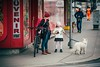 Choice (Tom Levold (www.levold.de/photosphere)) Tags: wien xt2 xf18135mm vienna street mother daughter bicycle girl fahrrad candid people mädchen dog hund