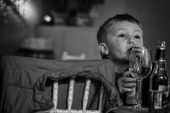 He likes his drink! (Frank Fullard) Tags: frankfullard fullard candid portrait orange drink alcohol mineral child boy wine lol fun family function
