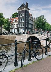 Amsterdam (borishots) Tags: 35mm 35mmf2 carlzeiss carlzeisssonnar carlzeisssonnar35mmf2 cybershot fullframe sonycybershotdscrx1 sonyrx1 zeiss zeisssonnar zeisssonnar35mmf2 sony amsterdam holland netherlands bicycle bike bikehandlebars bikes oldbike rust rusty rustybike bridge water buildings architecture old oldarchitecture canals