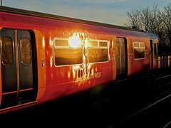 Glinting (Deepgreen2009) Tags: glint gleam sunset reflection bodyside red 455 train railway shiny windows swt