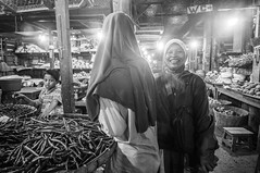 shy daughter, fun mother and a boy (kuuan) Tags: indonesia voigtländerheliarf4515mm manualfocus mf voigtländer15mm aspherical f4515mm superwideheliar apsc sonynex5n portrait solo surakarta street java market bazaar pasar pasarlegi stall women marketstall bw eyes eyecontact