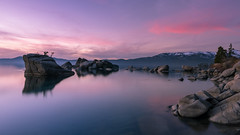 Lake Tahoe Sunset (Bryan the Roving Vagabond) Tags: laketahoe sunset dusk bluehour serene lake water rock granite clouds cloud tree sky mountain sierras landscape snow snowcap