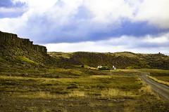 Little Church by the Rocks (ssleek) Tags: church mountains rocks field iceland road bluesky clouds