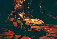 lc-a+ - panda car (johnnytakespictures) Tags: lomo lomography redscale redscalexr photo photography film analogue lca leamingtonspa leamington warwickshire police panda car vehicle law vauxhall orange red transport