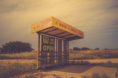 KEO kiosk (frattonparker) Tags: btonner lightroom6 nikond7000 raw frattonparker abandoned derelict disused kiosk beer advertisement bench roadside cyprus thebestyellow yellow neglected flypapertexture nikkor1855mmkitlens