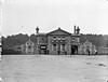 Railway Station House, Bagenalstown, Co. Carlow (National Library of Ireland on The Commons) Tags: robertfrench williamlawrence lawrencecollection lawrencephotographicstudio thelawrencephotographcollection glassnegative nationallibraryofireland bagenalstown countycarlow ireland railwaystation symmetrical design dog chickens ticketoffice muinebheag sanctonwood station cherrysale