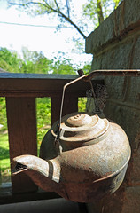 Cast Iron Kettle (FAIRFIELDFAMILY) Tags: flag front porch child boy young waving usa american arts crafts architecture design style winnsboro fairfield sc south carolina jason taylor climbing wall virginia grant stars stripes cast iron antique kettle pot spider web yard coffee old
