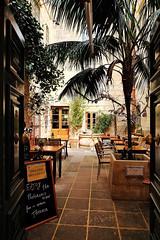 Coogi's (Douguerreotype) Tags: malta sign city restaurant cafe architecture door food