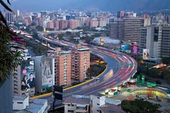 Morning in Caracas (Stig Nygaard) Tags: 2010 50d bolivarianrepublicofvenezuela canonefs1755mmf28isusm canoneos50d caracas creativecommons miranda photobystignygaard repúblicabolivarianadevenezuela urbanizaciónsanromán venezuela morning traffic cars longexposure s highway road sshape city outlook viewfromabove view cuw18 ven southamerica