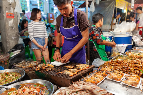 Man prepare prawns for sale
